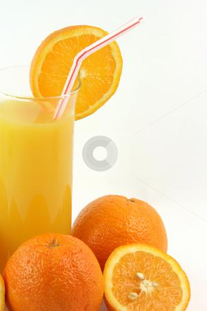 Glass orange juice stock photo, Healthy eating glass of orange juice with straw and slice of orange by EVANGELOS THOMAIDIS