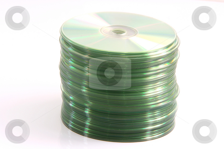Data cd raw stock photo, Computer data cd in vertical raw isolated on white background by EVANGELOS THOMAIDIS