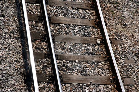Train rails horizontal stock photo, Train rails horizontal closeup for background use transportation industry by EVANGELOS THOMAIDIS