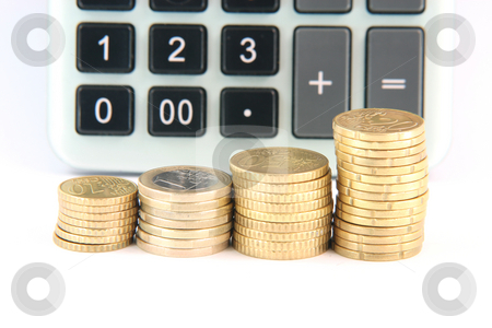 Blur calculator horizontal stock photo, Blur calculator background and euro currency coins isolated on white background with copy space horizontal by EVANGELOS THOMAIDIS