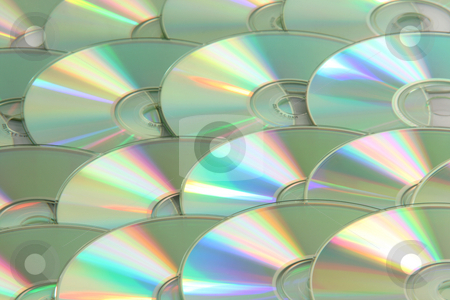 Background of discs stock photo, Background full of blank compact discs technology concepts by EVANGELOS THOMAIDIS