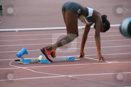 Woman at starting point stock photo, Woman sprinter at starting point on the move sport and athlets by EVANGELOS THOMAIDIS