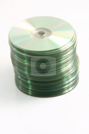 Data cd stock photo, Computer data cd in vertical raw isolated on white background by EVANGELOS THOMAIDIS
