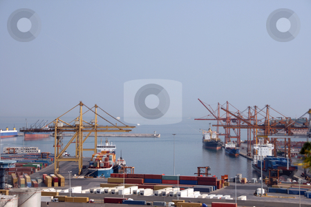 Cargo transportations stock photo, Shipping industry cargo ship and containers at the port of piraeus athens greece no visible logos on containers by EVANGELOS THOMAIDIS