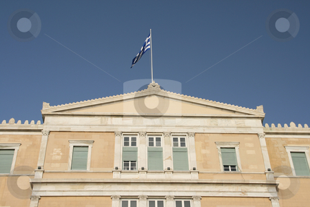 Detail from parliament stock photo, Exterior detail from greek parliament with the flag on total blue sky landmakrs of athens greece by EVANGELOS THOMAIDIS
