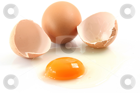 Breakfast eggs stock photo, Two eggs one is broken food concepts isolated on white background by EVANGELOS THOMAIDIS