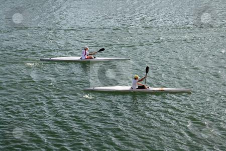 Canoe practice stock photo, Two boys doing conoe practice sport and athletes concepts by EVANGELOS THOMAIDIS