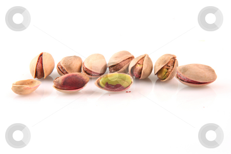 Seeds of pistachio stock photo, Open pistachios isolated on white background food concepts by EVANGELOS THOMAIDIS