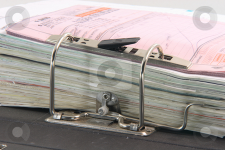 Accounting work stock photo, Detail from open archive  business folder with binders by EVANGELOS THOMAIDIS