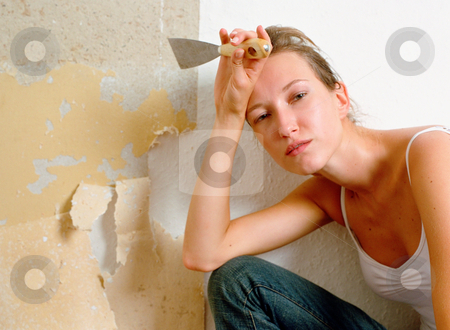 MPIXIS574013 stock photo, Tired woman holding scraper by Mpixis World