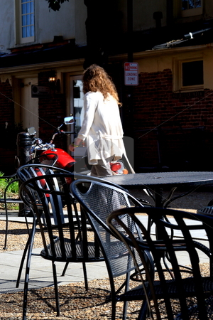 City person stock photo, Pedestrian walking into a cafe by Jack Schiffer