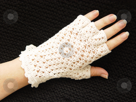 Crocheted Glove stock photo, White crocheted glove with black background by Jack Schiffer