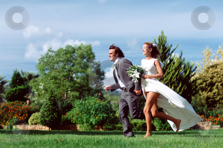 MPIXIS555003 stock photo, Newlyweds running in field by Mpixis World