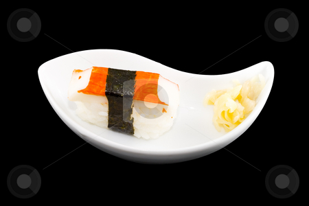 Sushi stock photo, A white plate with a piece of sushi by Petr Koudelka