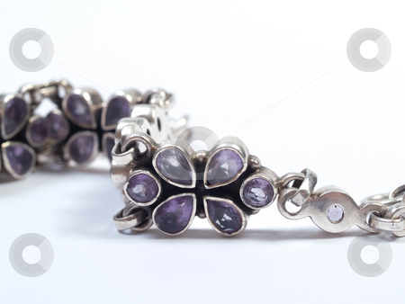 Purple silver bracelet stock photo, Purple bracelet on white isolated background by Adrian Costea