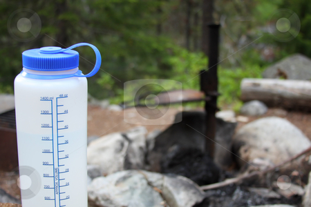Camp Drink stock photo, Camping water bottle in a forest campsite setting. by Steve Stedman