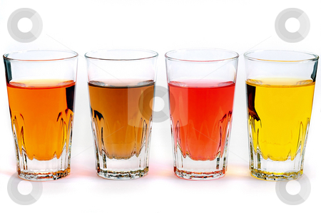 Glass with colored water stock photo, An artistic view of small glasses filler with water of four different colors by Emmanuel Keller