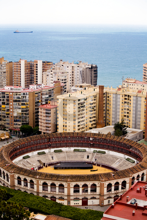 View To Malaga stock photo, Bullring between buildings in Malaga, Andalusia, Spain by Vitaly Sokolovskiy