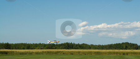 Remote Control Plane stock photo, A small remote control plane coming in for a landing in a field by Richard Nelson