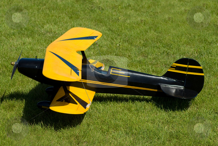 Model Airplane stock photo, A remote control model airplane sitting in the grass by Richard Nelson
