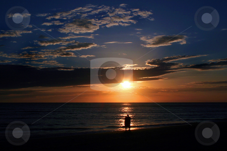 Romantic Sunset stock photo, A couple standing watching the beautiful sunset. by Lucy Clark