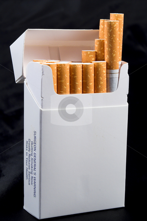 Pack of Cigarettes stock photo, A pack of nicotine laden tobacco cigarettes. by Robert Byron