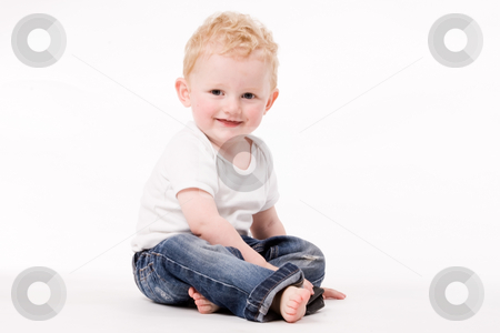 Smiling on my place stock photo, Cute caucasian blond toddler ishappy and playfull by Frenk and Danielle Kaufmann