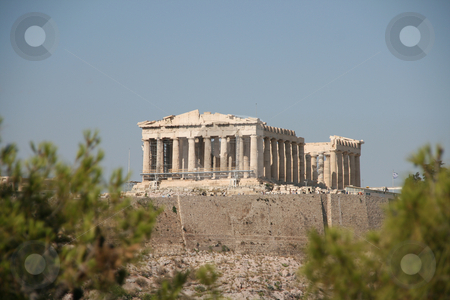 Trees and acropolis stock photo, The acropolis of athens greece between trees famus landmarks by EVANGELOS THOMAIDIS