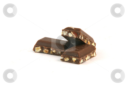 Almond chocolate pieces stock photo, Three almond feel chocolate pieces closeup with copy space isolated on white background food and sweets concepts by EVANGELOS THOMAIDIS