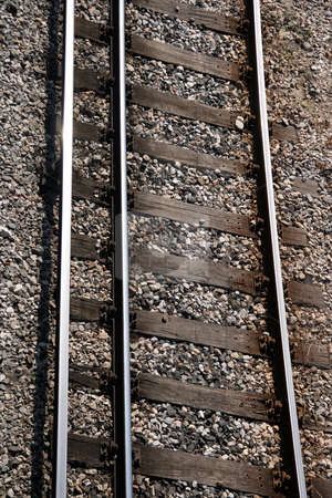 Train rails closeup stock photo, Train rails vertical closeup for background use transportation industry by EVANGELOS THOMAIDIS