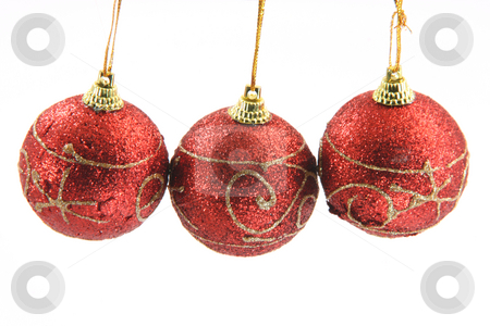 Christmas balls stock photo, Three red christmas decoration balls hanging isolated on white background uper view by EVANGELOS THOMAIDIS