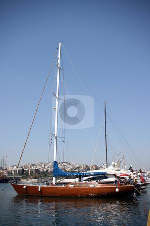Sail yacht stock photo, Luxury sail yacht at marina and city view background at piraeus athens greece by EVANGELOS THOMAIDIS