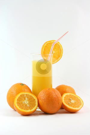 Oranges and juice stock photo, Healthy eating glass of orange juice with straw and slice of orange and oranges by EVANGELOS THOMAIDIS