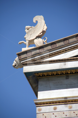 Shinx statue detail stock photo, Neoclassical architecture details decoration sculptures and shinx statue on the roof by EVANGELOS THOMAIDIS