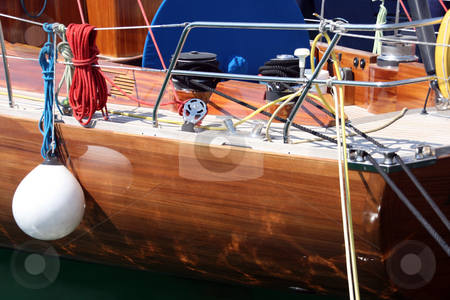 Sail yacht details stock photo, Ropes and deck details  from luxury sail yacht at marina by EVANGELOS THOMAIDIS