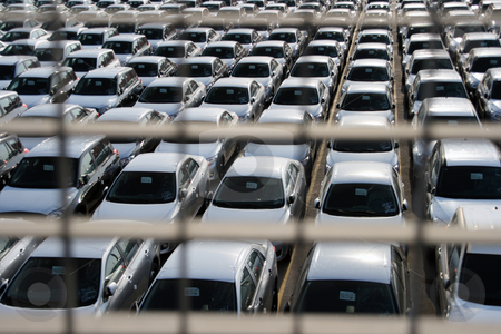 Cars behind bars stock photo, Cars behind bars view of customs area with new imported cars by EVANGELOS THOMAIDIS