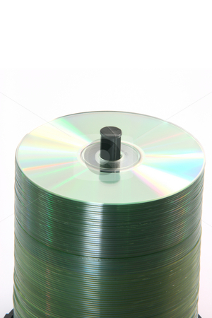 Stack of blank cds stock photo, Detail of a blanck copact discs stack isolated on white background by EVANGELOS THOMAIDIS