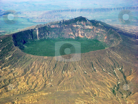Mount Longonot stock photo, The crater of the Mount Longonot taken from an airplane. This is a dormant volcano located in Kenya by Emmanuel Keller
