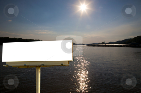White Billboard and River stock photo, Brand new billboard in the setting sun over the mississippi river. by Mitch Aunger