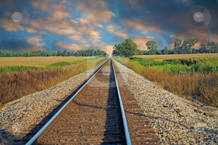 Railroad tracks stock photo, Train tracks running into the distance by Mitch Aunger