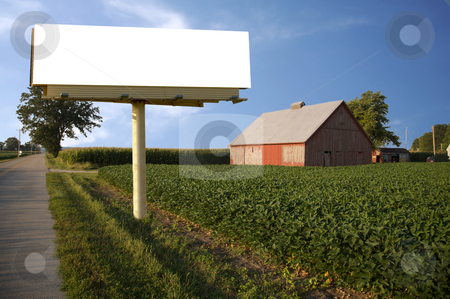 Farm with Barn and white billboard stock photo, Brand new billboard in the field next to a farm - great farming advertisement! by Mitch Aunger