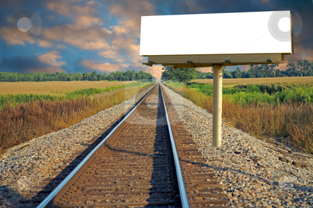 White Billboard and Railroad stock photo, A railroad going thru a farm with a roadside billboard by Mitch Aunger