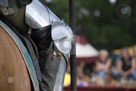 Knight's Knee stock photo, Stock photo of a close up of a knight's armor as he charges towards his opponent on his horse, lance in hand. by Maria Bell