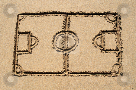 A soccer pitch drawn on a sandy beach. stock photo, A soccer pitch drawn on a sandy beach. by Stephen Rees
