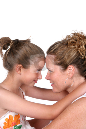 Mother and daughter with foreheads touching