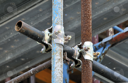 Scaffolding clamps stock photo, Detail of scaffolding with pipes and holdfasts by Massimiliano Leban