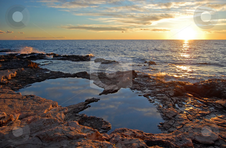 Sunset stock photo, Sunset on a rock coastline with a puddle by Massimiliano Leban