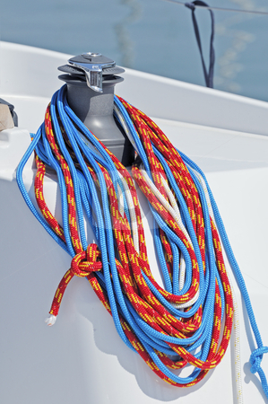 Sailboat detail stock photo, Coloured ropes wrapped on a winch of a boat by Massimiliano Leban