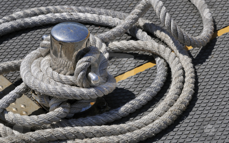 Moored boat stock photo, Close-up of a steel bitt and rope by Massimiliano Leban