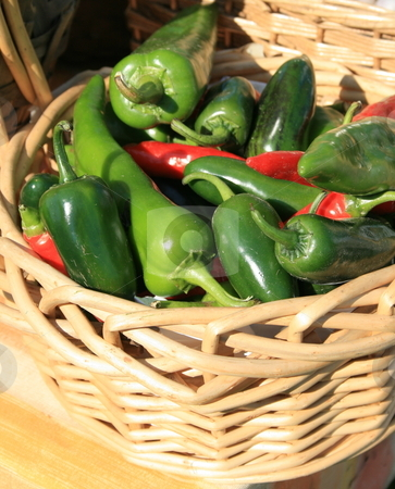 Green Peppers  stock photo, Green peppers in a basket at the farmers market by Tom and Beth Pulsipher